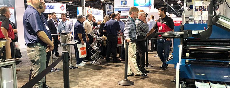 convention goers admiring BossJet digital inkjet printer